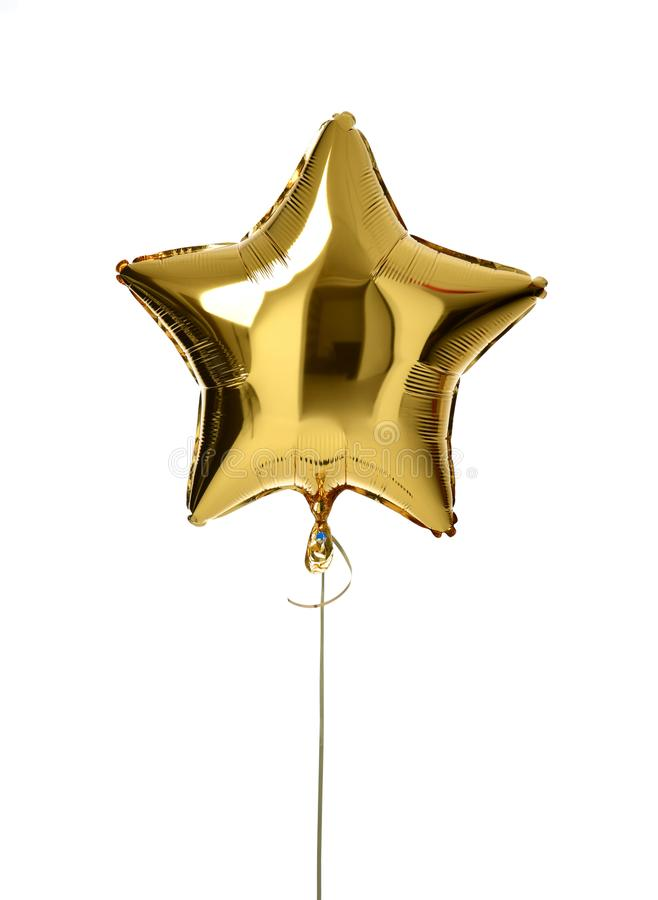 Single big gold star balloon object for birthday party royalty free stock photo