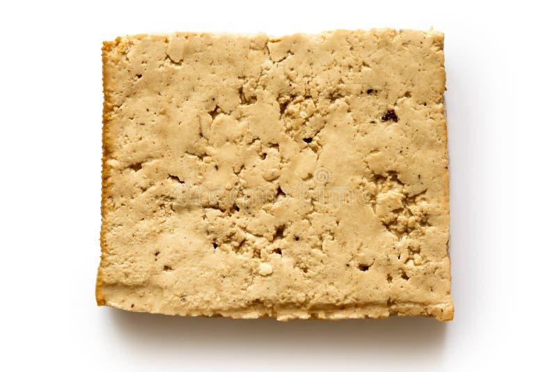 Single block of lightly smoked tofu isolated on white.e royalty free stock image