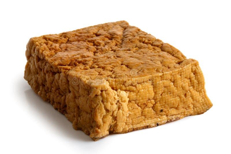 Single block of smoked tofu. stock image