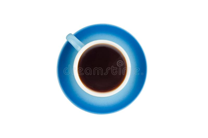 Single blue ceramic cup with handle full of hot fresh black coffee on circle saucer isolated on white background. Top view. Clipping path stock image