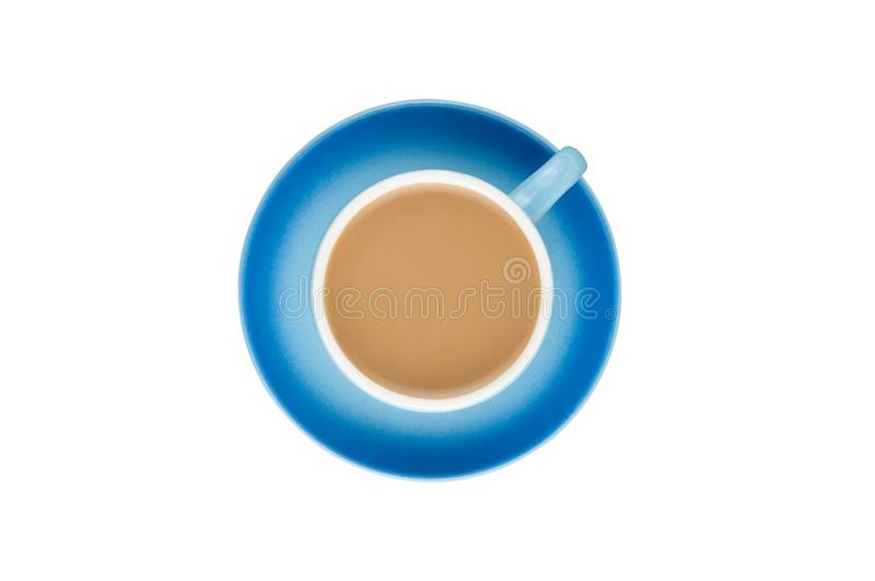 Single blue ceramic cup with handle full of hot fresh coffee with milk on circle saucer isolated on white background. Top view. Clipping path royalty free stock photos