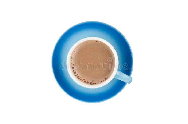 Single blue ceramic cup with handle full of hot fresh coffee with milk on circle saucer isolated on white background. Top view. Clipping path royalty free stock images