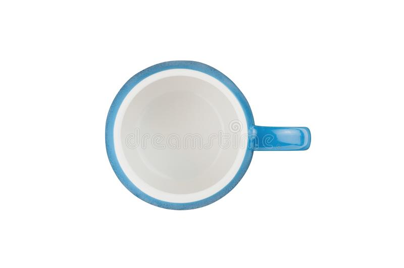 Single blue empty ceramic cup for drinks or other liquid products isolated on white background. Top view royalty free stock photography