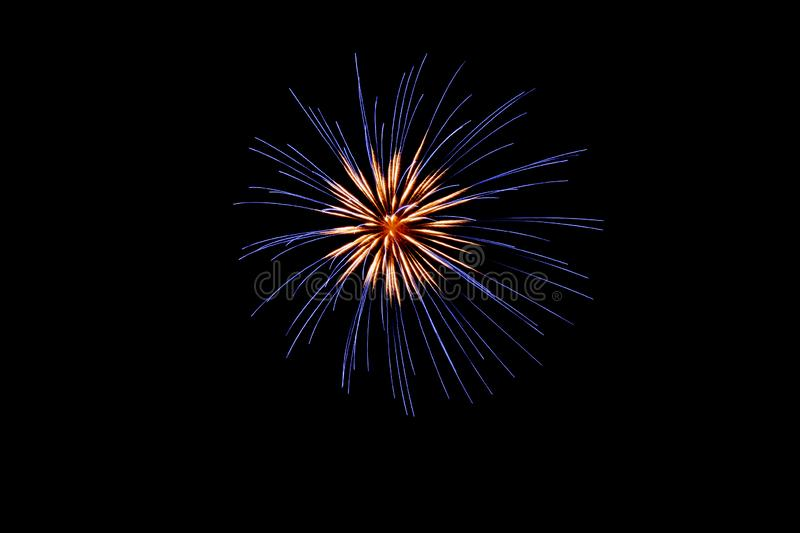 Blue and white pyrotechnic fireworks in the night. A single Blue and white pyrotechnic fireworks effect in the night in France royalty free stock photo