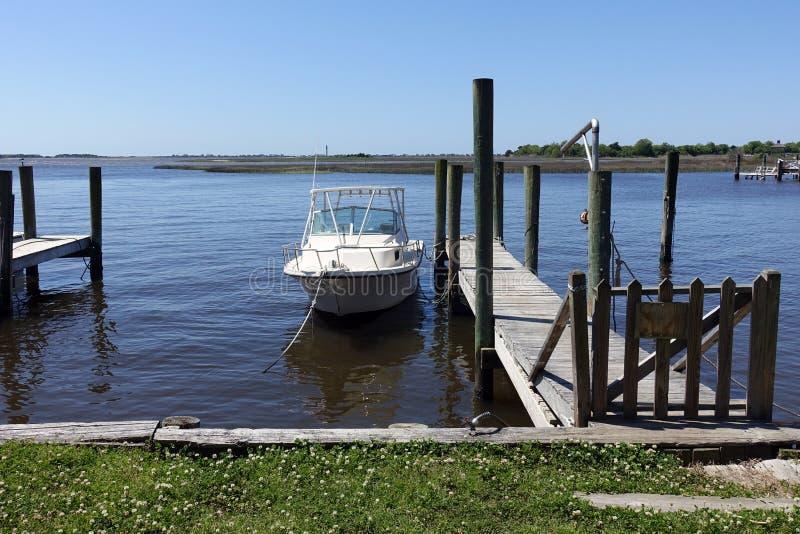 A Single Boat Docked in a Marina in Southport, NC. A Single Motorboat Docked in a Marina in Southport, North Carolina royalty free stock photo