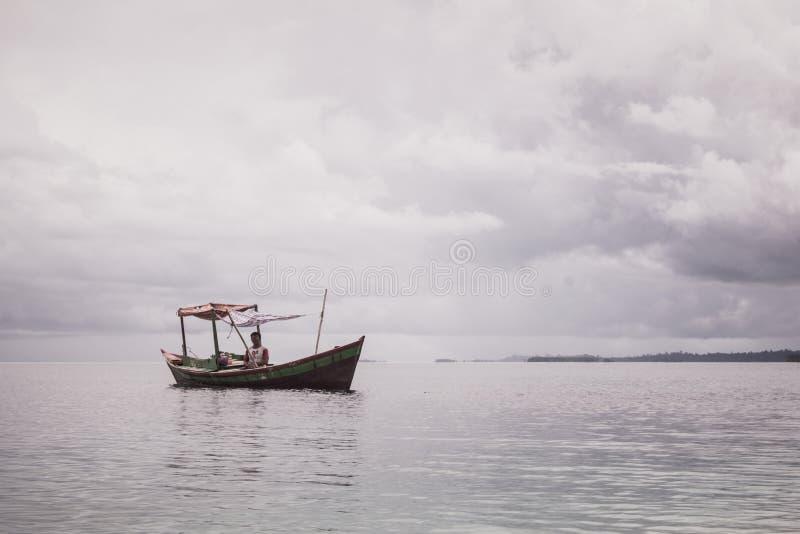 Single boat in the sea stock photo
