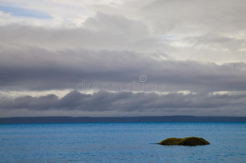 A single boulder in the ocean near Vancouver Island, British Columbia royalty free stock images