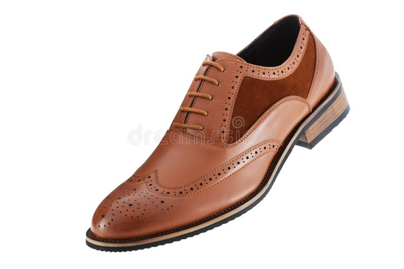 Single brown leather and suede men`s shoe inclined isolated on a white background with clipping path stock photography