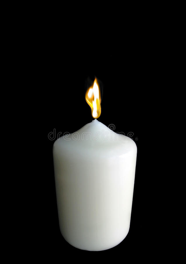Single burning candle. Photo of a single burning candle with black space above for putting type etc royalty free stock images