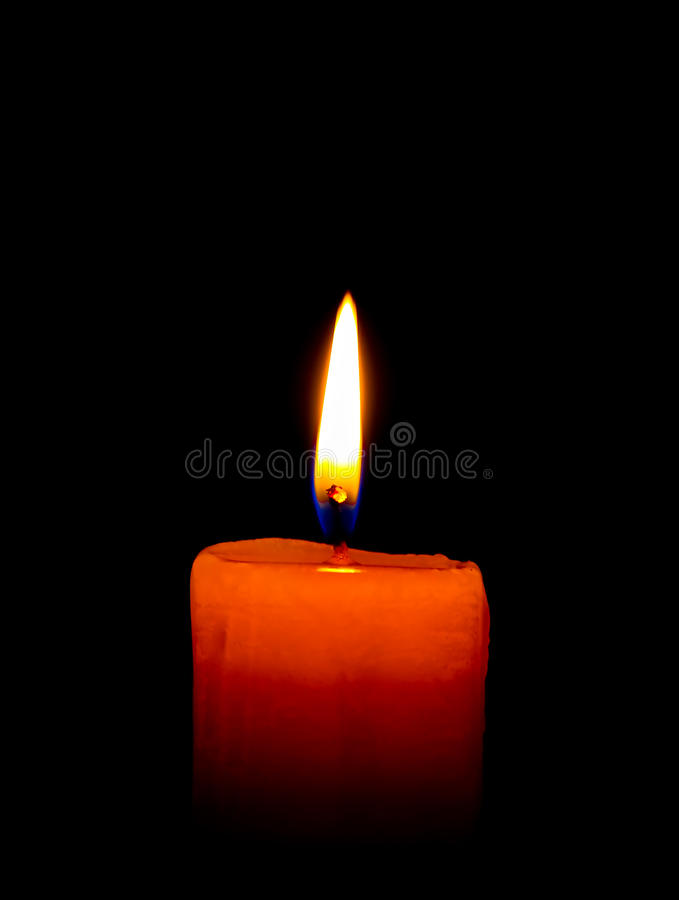 A single burning candle isolated on black. In thailand stock images