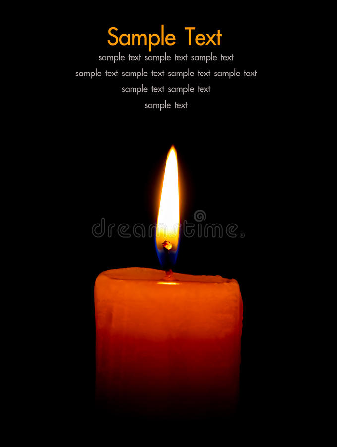 A single burning candle isolated on black. A single burning red candle isolated on black royalty free stock photography