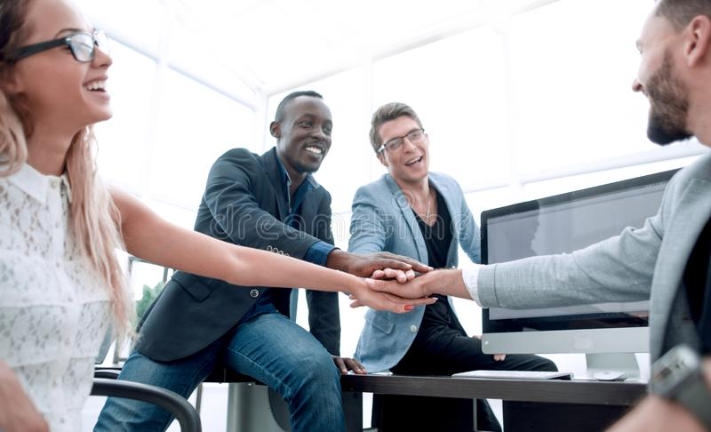 Single business team with their hands folded together. Photo with copy space stock photos
