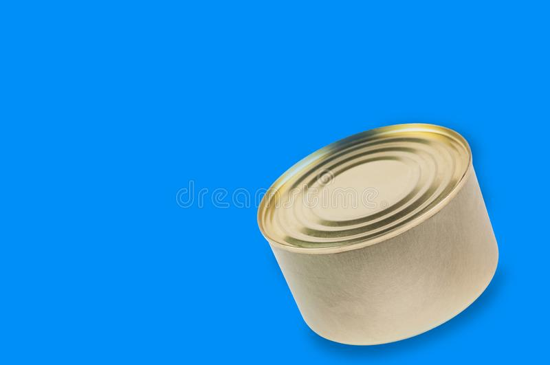 Single can of canned food on blue background with copy space. For your text royalty free stock photos