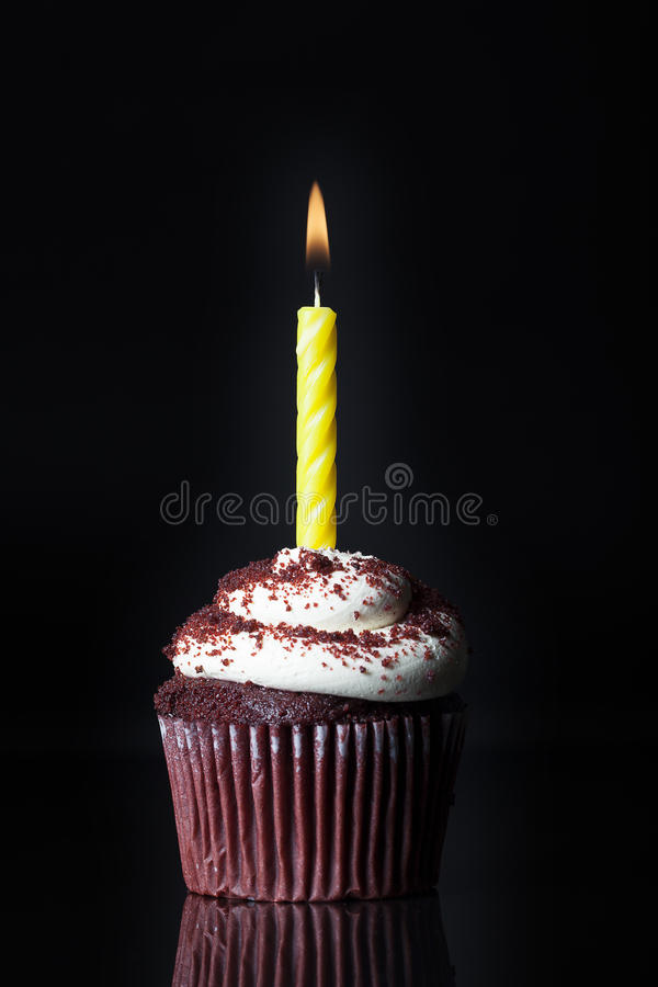Single Candle on Cupcake royalty free stock image
