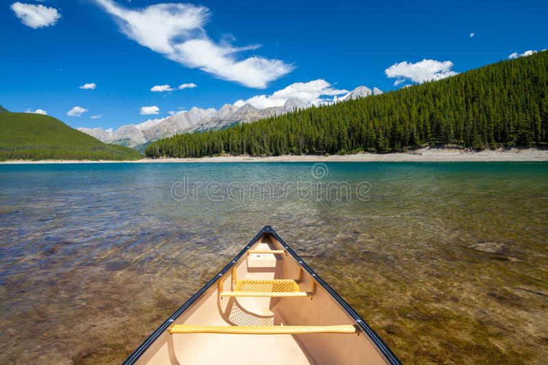 A single canoe on a mountain lake royalty free stock photos