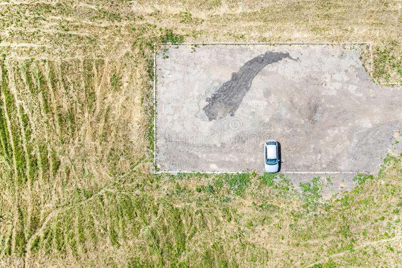 Single car on empty parking lot. aerial view stock image