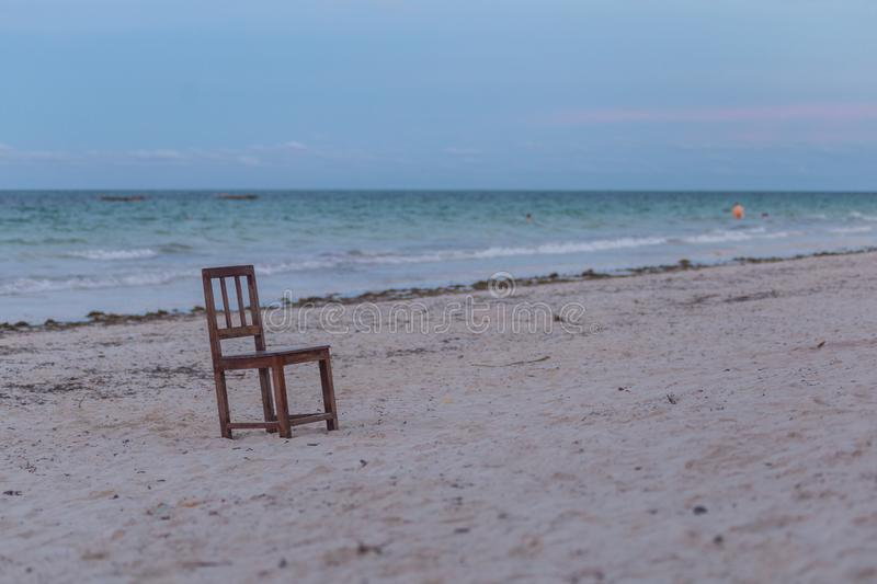 A single chair on the beach. Seascape with chair. Travel around Africa. 2018.02.21, Kiwengwa, Tanzania. Travel around Tanzania. A single chair on the beach royalty free stock photography