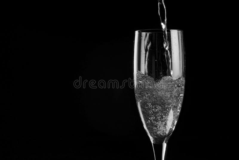 Single Champagne Flute Filled With Sparkling Wine Royalty Free Stock Image