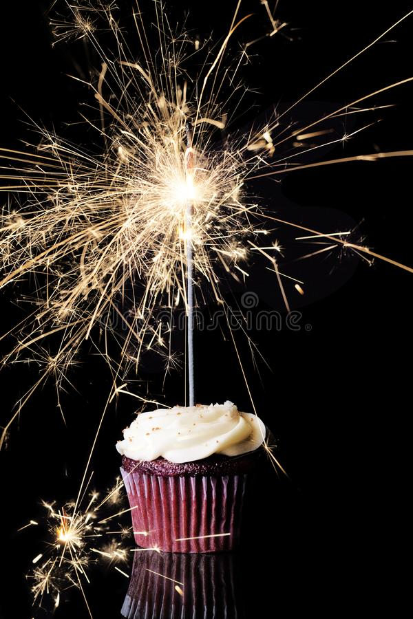 Single Chocolate Cupcake with Sparkler royalty free stock photo