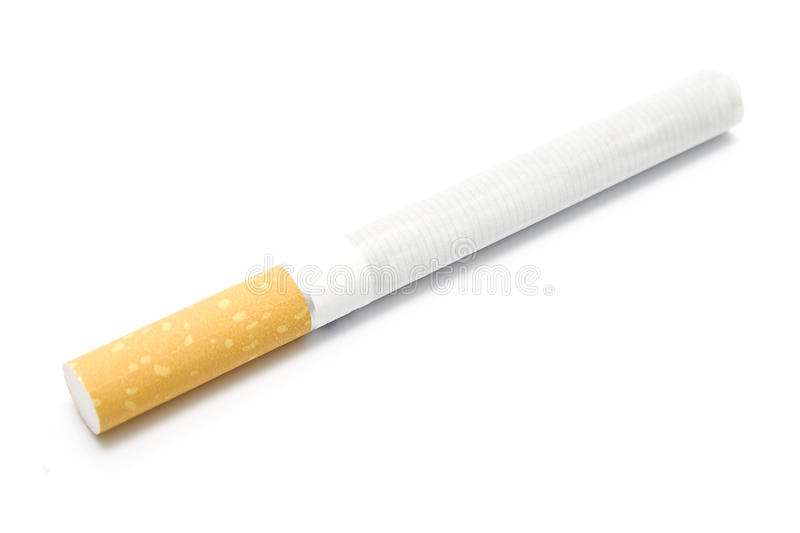 Single cigarette. On white background royalty free stock photos