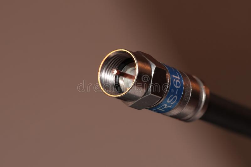 Single coaxial cable. Coaxial black cable with F blue connector royalty free stock image