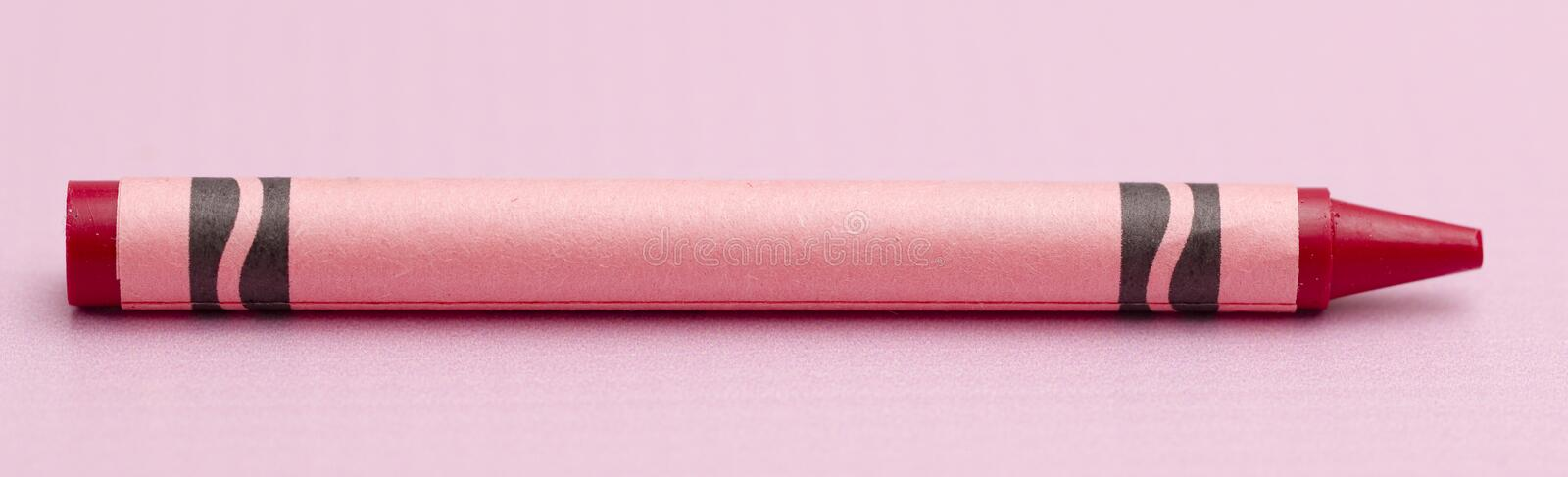 A Single Crayon. On a Pink Background stock image