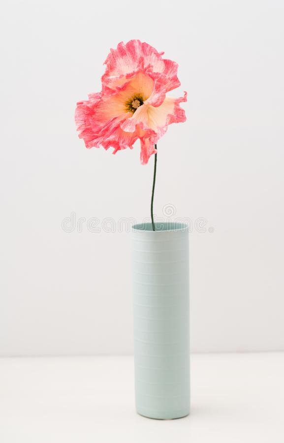 Single crepe paper poppy royalty free stock photography