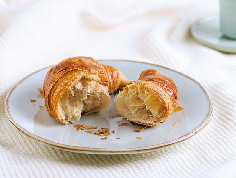 Single croissant for breakfast on woolen surface. Croissant for breakfast on woolen surface stock images