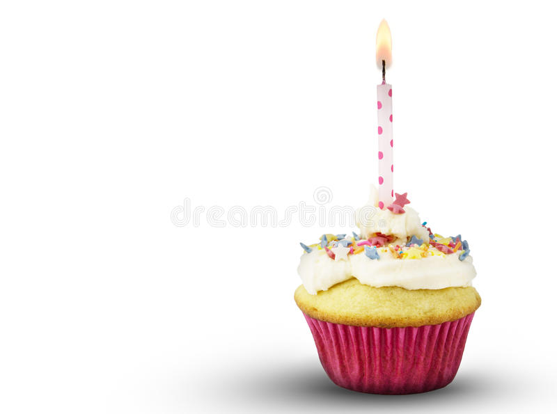 Single cup cake with lit pink spotted candle isolated on white b stock image