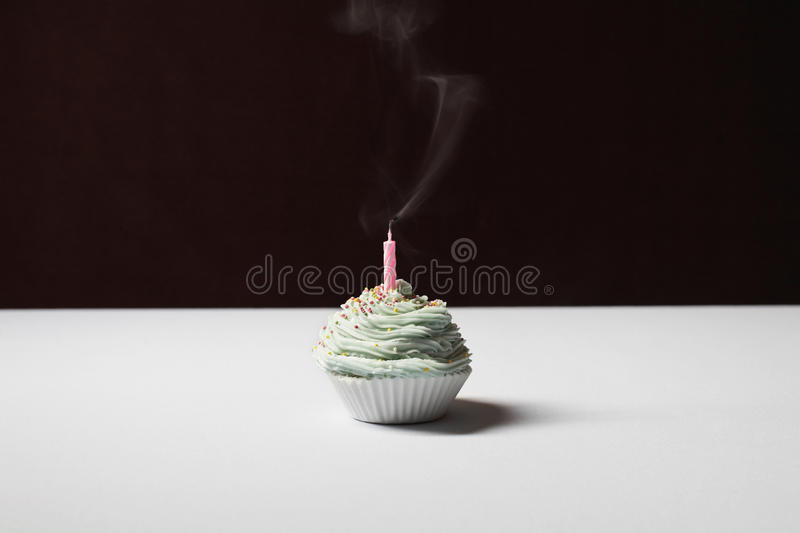 Single Cupcake With Extinguished Birthday Candle stock photos