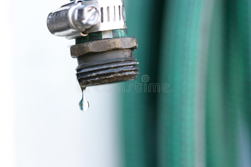 Single droplet of water is about to break free stock photos
