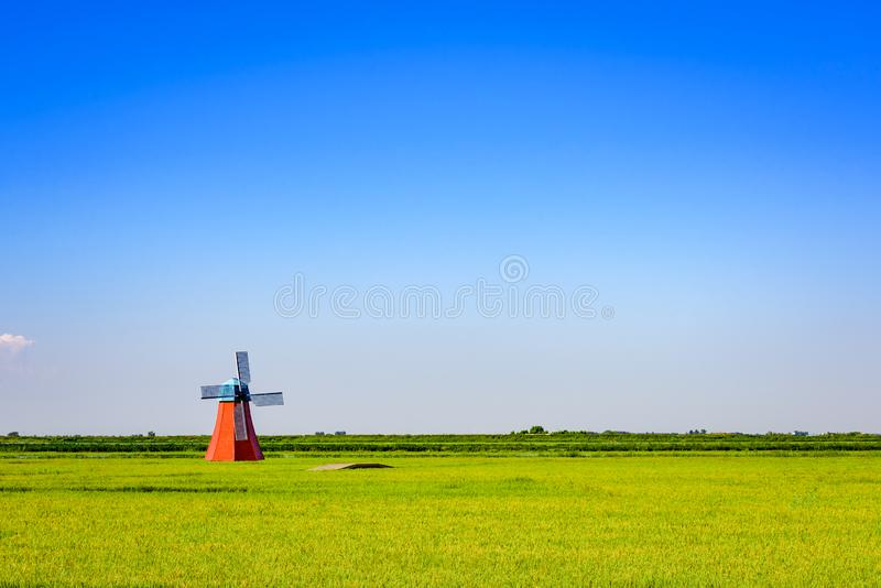 Dutch style windmill with blue sky, Panjin, Liaoning, China. Single Dutch style windmill with blue sky, Panjin city, Liaoning, China royalty free stock image