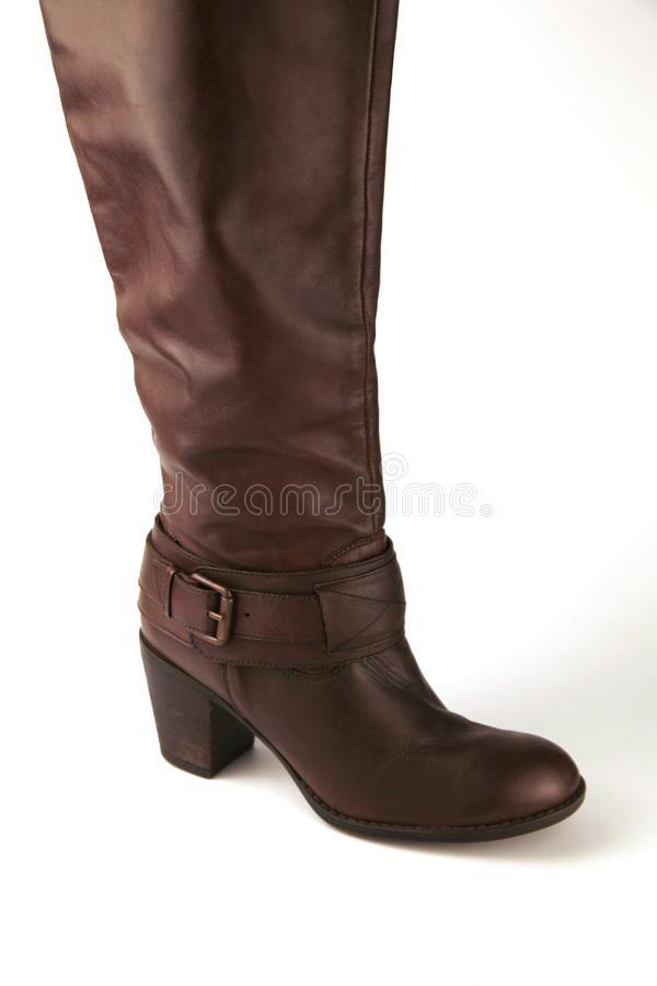 Beautiful long leather boot in brown royalty free stock image