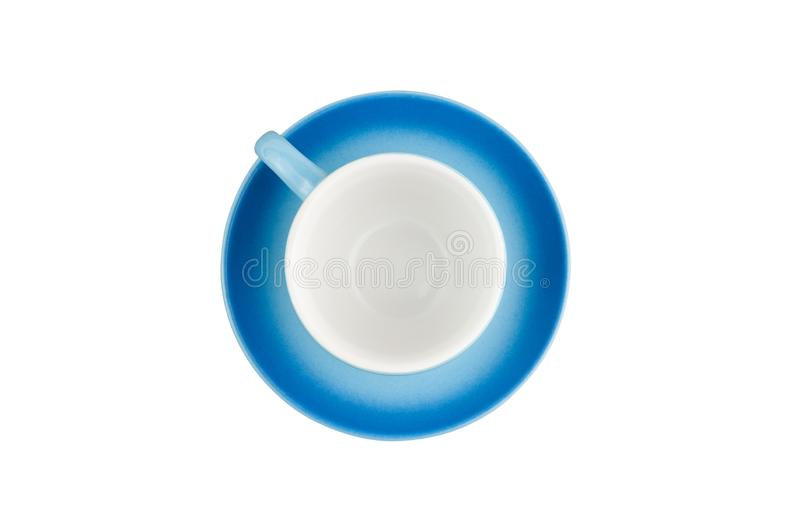 Single empty blue ceramic cup with handle on circle saucer isolated on white background. Top view. Clipping path stock photos