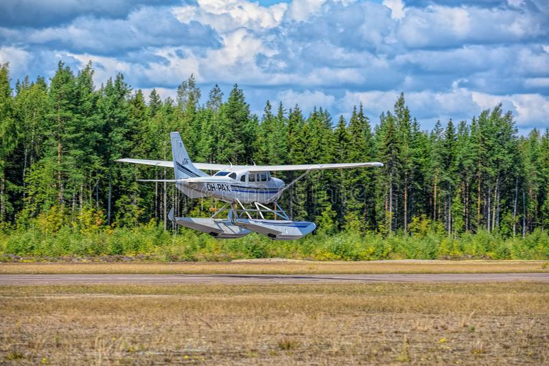 Single-engined piston-powered aircraft with fixed landing gear Cessna T206H Turbo Stationair OH-PAX amphio floats take of from. KOTKA, FINLAND - Aug 10, 2019 stock photos