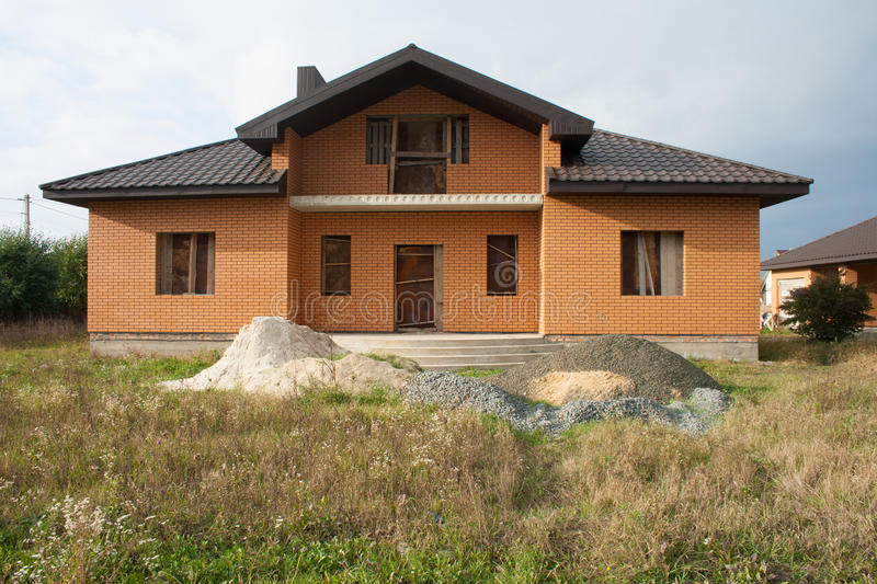 A single family home under construction. A house without finishing work inside the house royalty free stock image