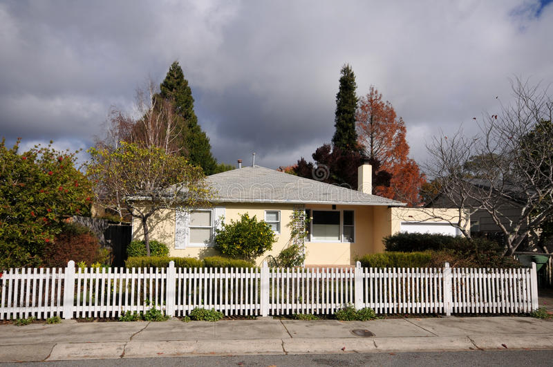 Single family house one story with picket fence stock photos