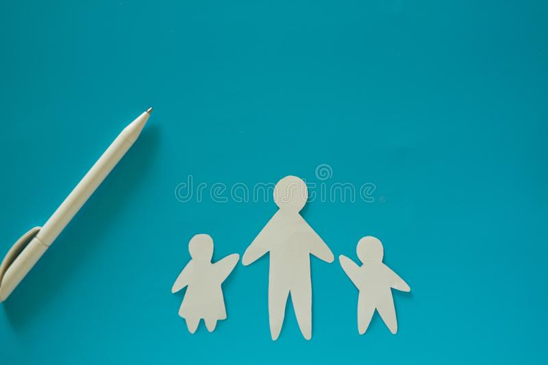 Single father concept image. Paper father with children stock image
