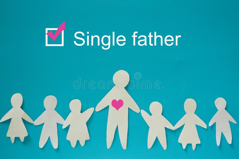 Single father concept image. Paper father with children royalty free stock photo