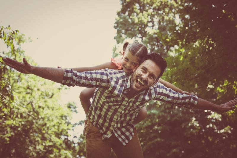 Single father with little daughter in meadow. Little girl lying stock images
