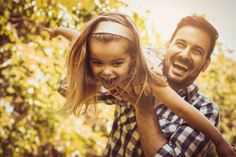 Single father playing in the meadow with daughter. Enjoying in s stock photography