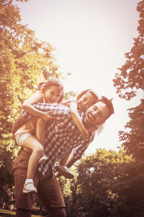 Single father playing in nature with his daughter. Father carryi royalty free stock image