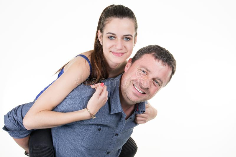 Father with teenager daughter make piggyback. Single father with teenager daughter make piggyback stock photos