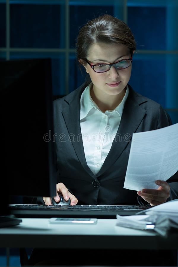 Single female workaholic royalty free stock photography