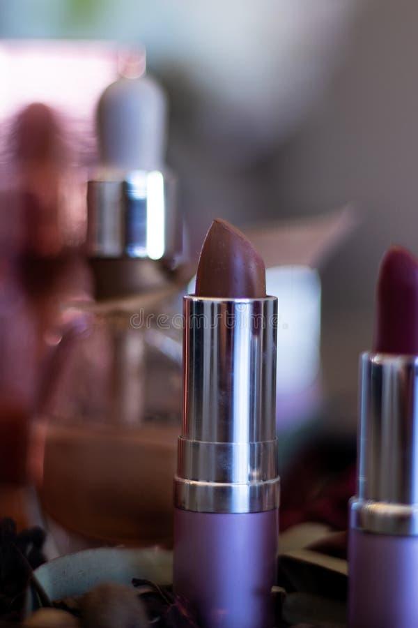 Single focus on ladies lipstick tube stock photo