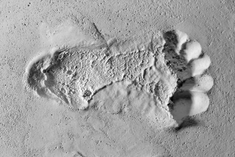 single Footprint impression on white sandy surface royalty free stock photos