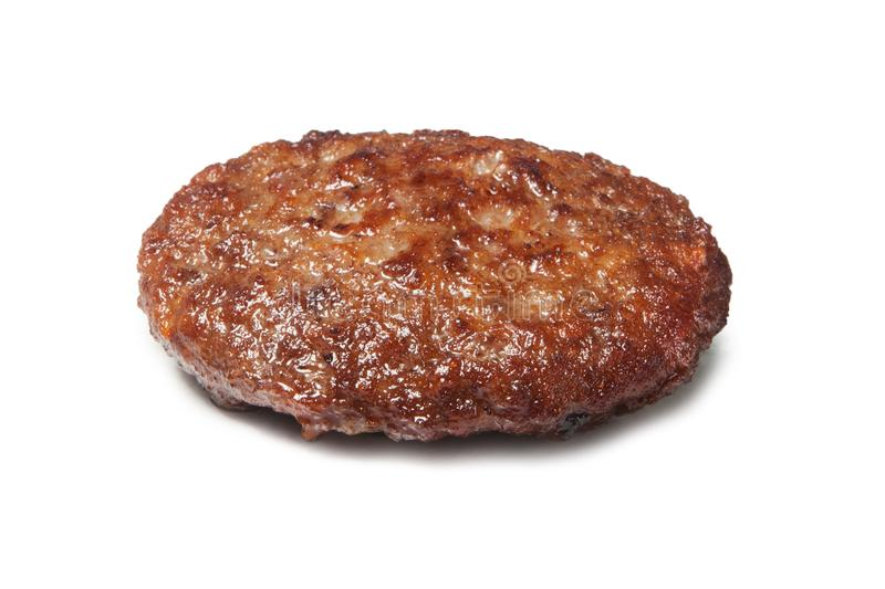 Single fried hamburger patty isolated on white stock image
