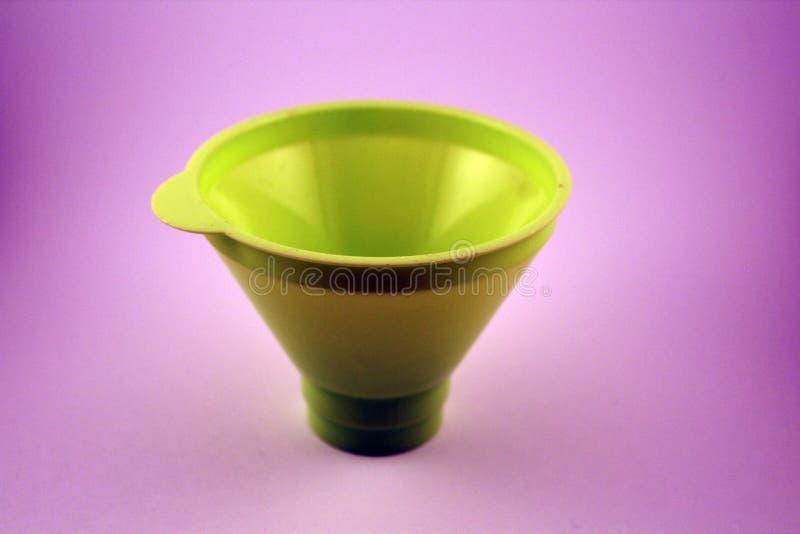 Single funnel on violet background stock photo