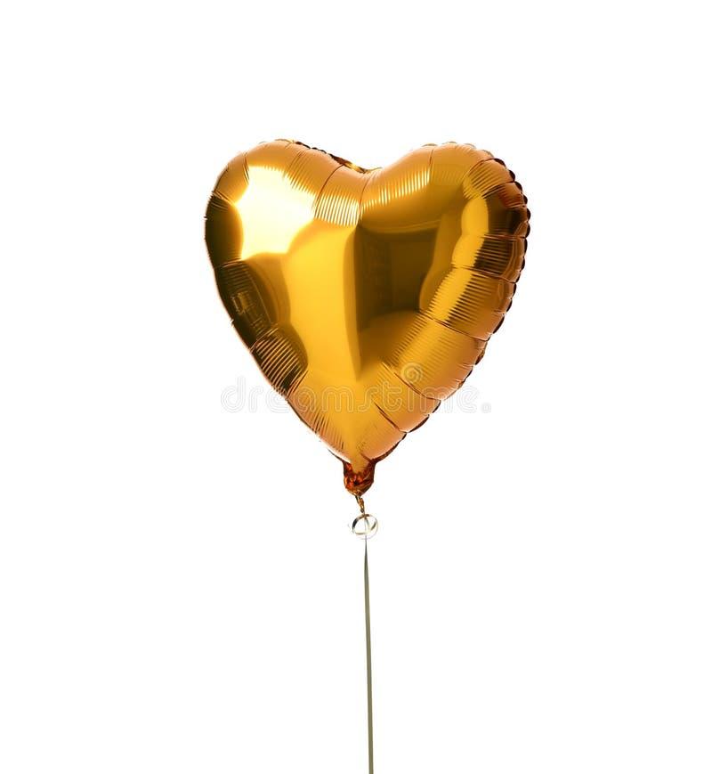 Single gold big heart metallic balloon for birthday isolated stock images