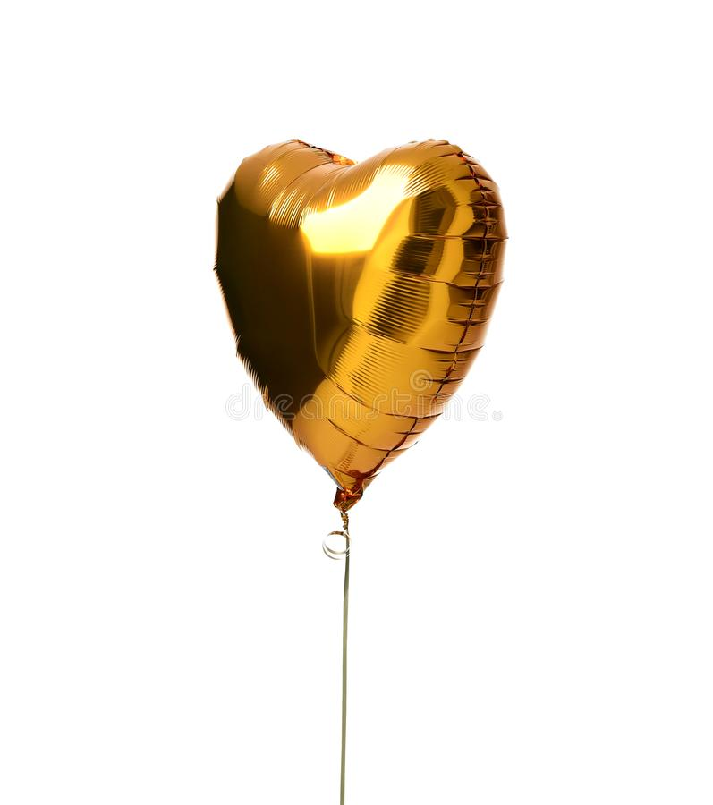 Single gold big heart metallic balloon for birthday isolated royalty free stock photo